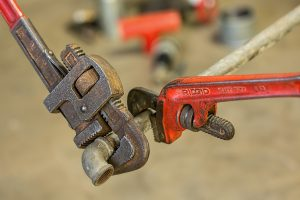 plumbing-wrenches-on-pipe